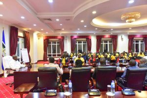 President Museveni talks to players at State House