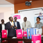 Give and take; Kyambogo University and Movit exchange gifts after signing the MoU.
